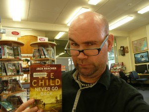 "Muswellbrook Campus Librarian Mitch White with the top read - Lee Child's ""Never Go Back"""